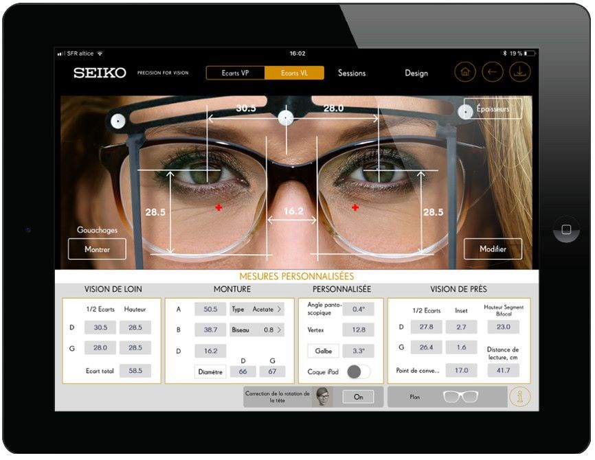 Tablet screen showing measurements of eyeglasses on a female face