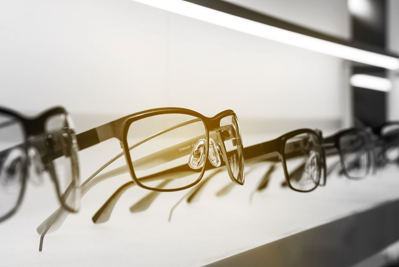 Eyeglass frames sitting in a display cabinet