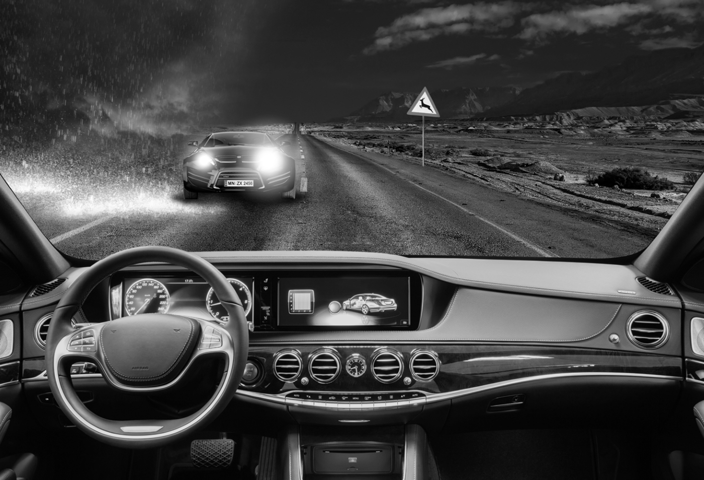 Black and white image of car dashboard