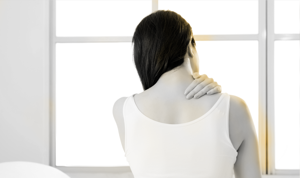 Female suffering from neck pain