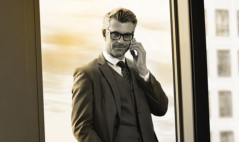Male businessman wearing eye glasses on a phone call