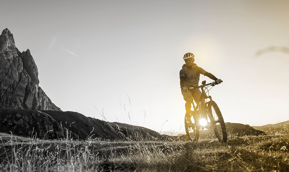 Male mountain biker on a bicycle wearing helmet