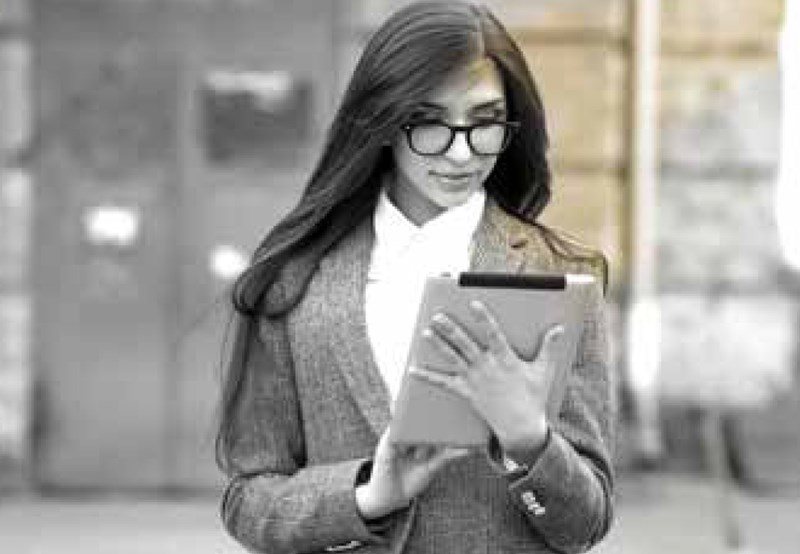Female wearing eyeglasses on tablet